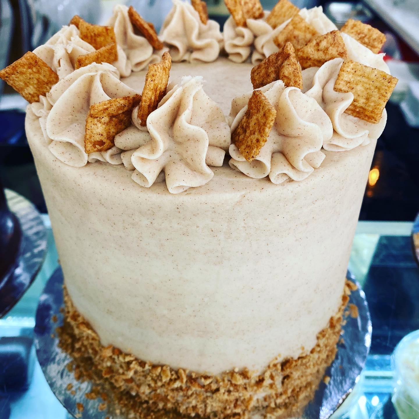 Cinnamon Toast Crunch Cake- Cinnamon cake with brown sugar buttercream and your favorite cereal inside and out.