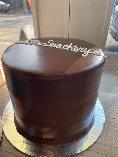Snackery Singnature- Snackery Cake- Rich chocoalte cake stuffed with a marshmallow core and covered in ganache - can be customized on the swirl