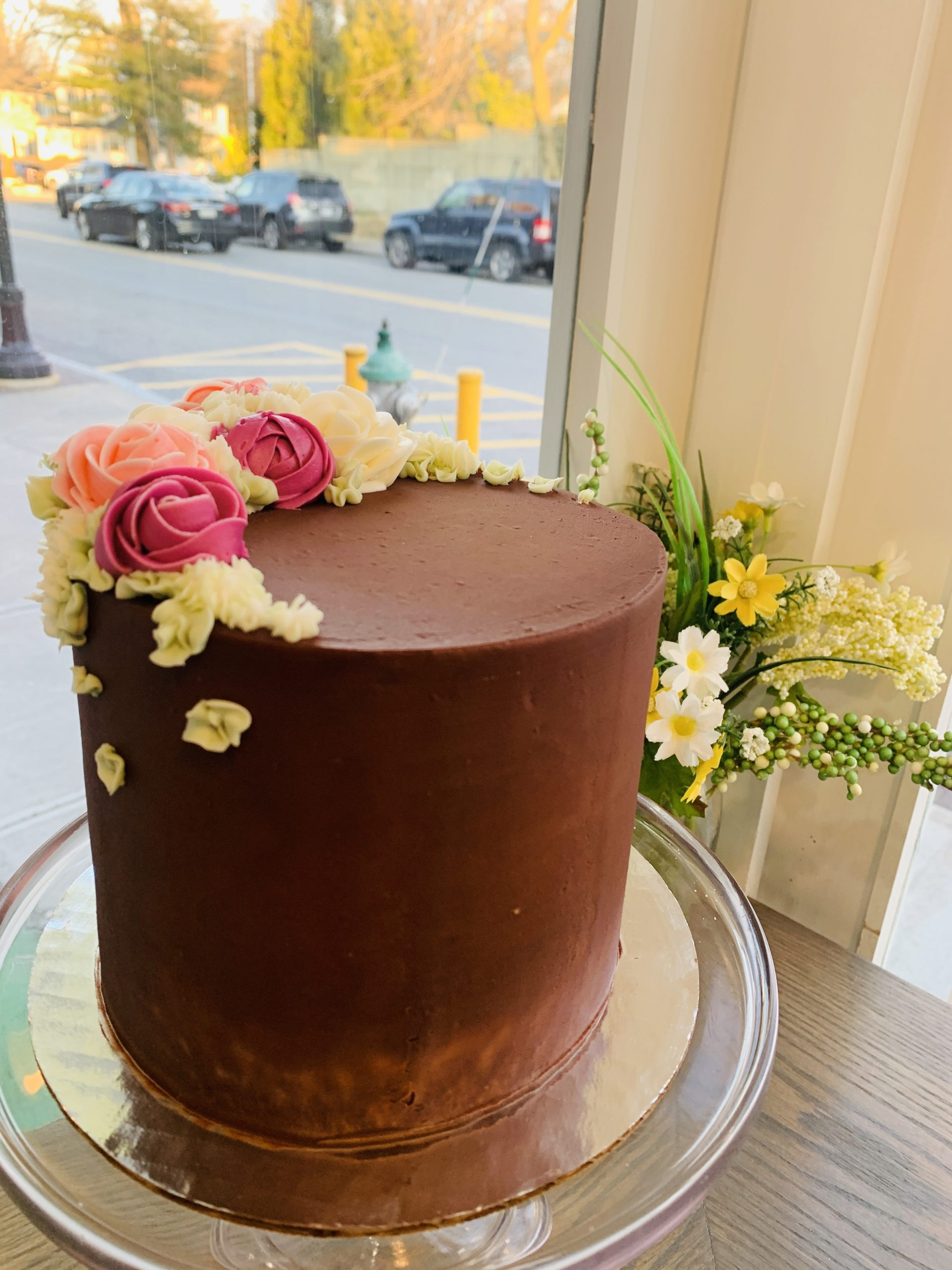 Gluten Free Everyday Celebration Cake- 3 layers of golden gluten free cake with chocolate fudge frosting and beautiful flower finish