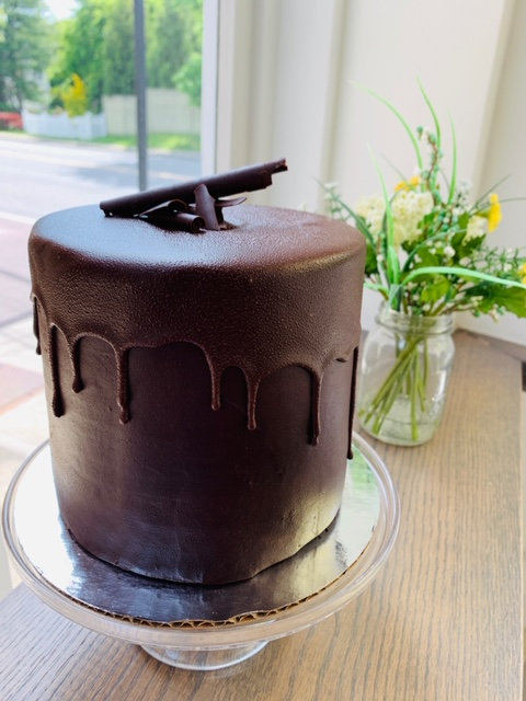 Devil Made Me Do It Cake- Three layers of rich Devils food cake, dark chocolate filling and chocolate ganache.