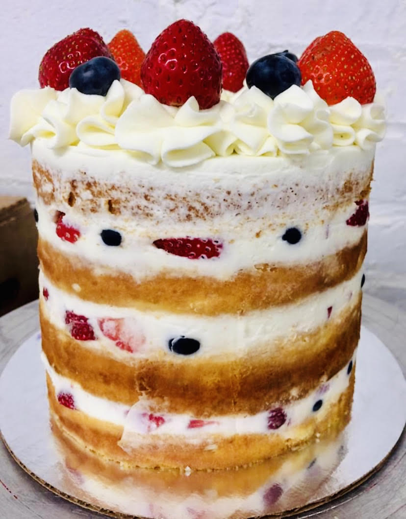 Berry-lious Double Berry Summer Shortcake- Four layers of vanilla cake with blueberry and strawberry wrapped in our delicious whipped cream
